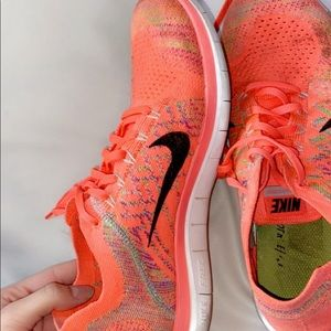 Women's nike fly knit orange shoes
